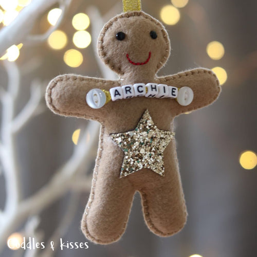 Gingerbread man with gold star decoration