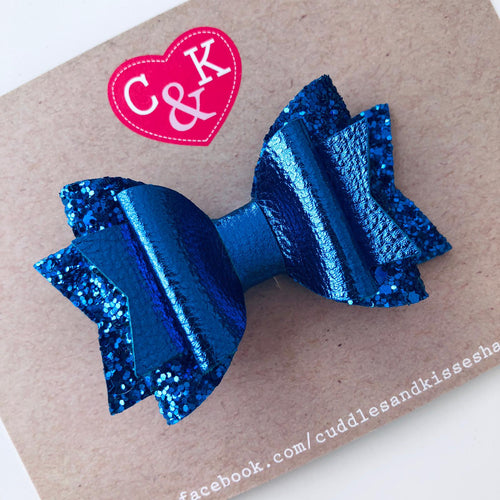Electric blue sparkly bow