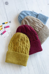 hand knitted warm womens beanies in mustard beige and blue