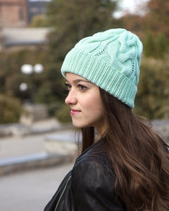 mint green knitted hat with braids