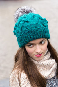 teal woolly hat with pom pom