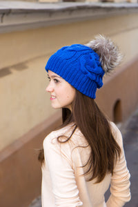 cobalt blue cable knit hat with real fur bobble