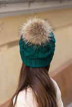 knitted beanie with brown fur pom pom