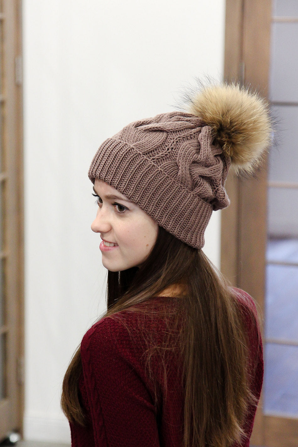 brown merino wool knitted hat with fur pom pom