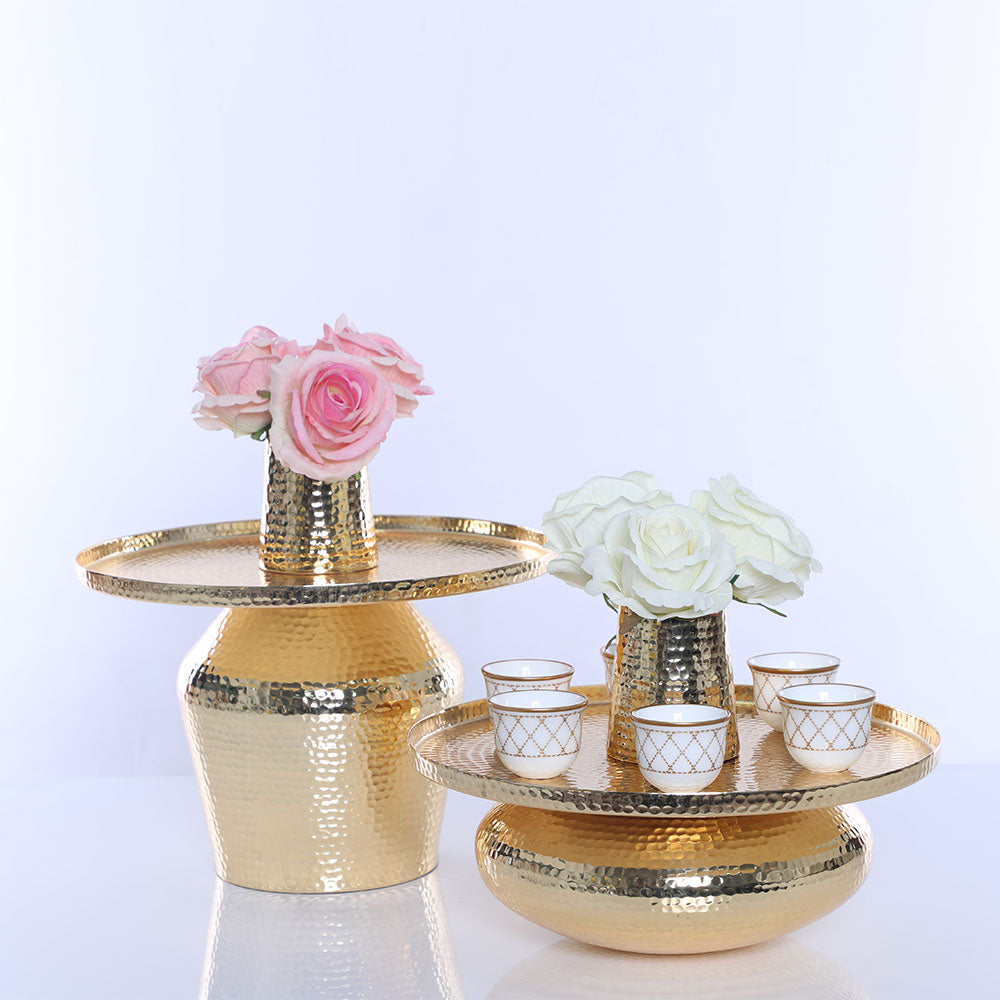 Glittering Glamour: The honouring of culture and diverse inclusion is reflected in the design of the glittering gold Vase and Tray with hammered detail from JARS.  When paired with the HM Quilt Mat Gold Gawa Cups Set, you will find the perfect serenity
