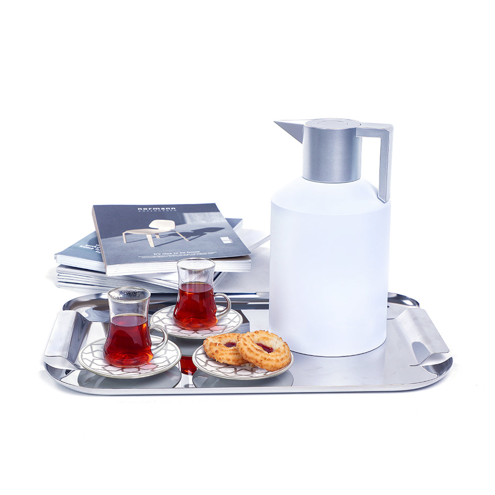 Contemporary Style: With this Eid Hamper you get the supreme quality and modern style of the white sliver Normann Copenhagen Geo Vaccum Flask with the traditionally innovative fusion of the HM Dervish Star Mat Platinum Tea Set .