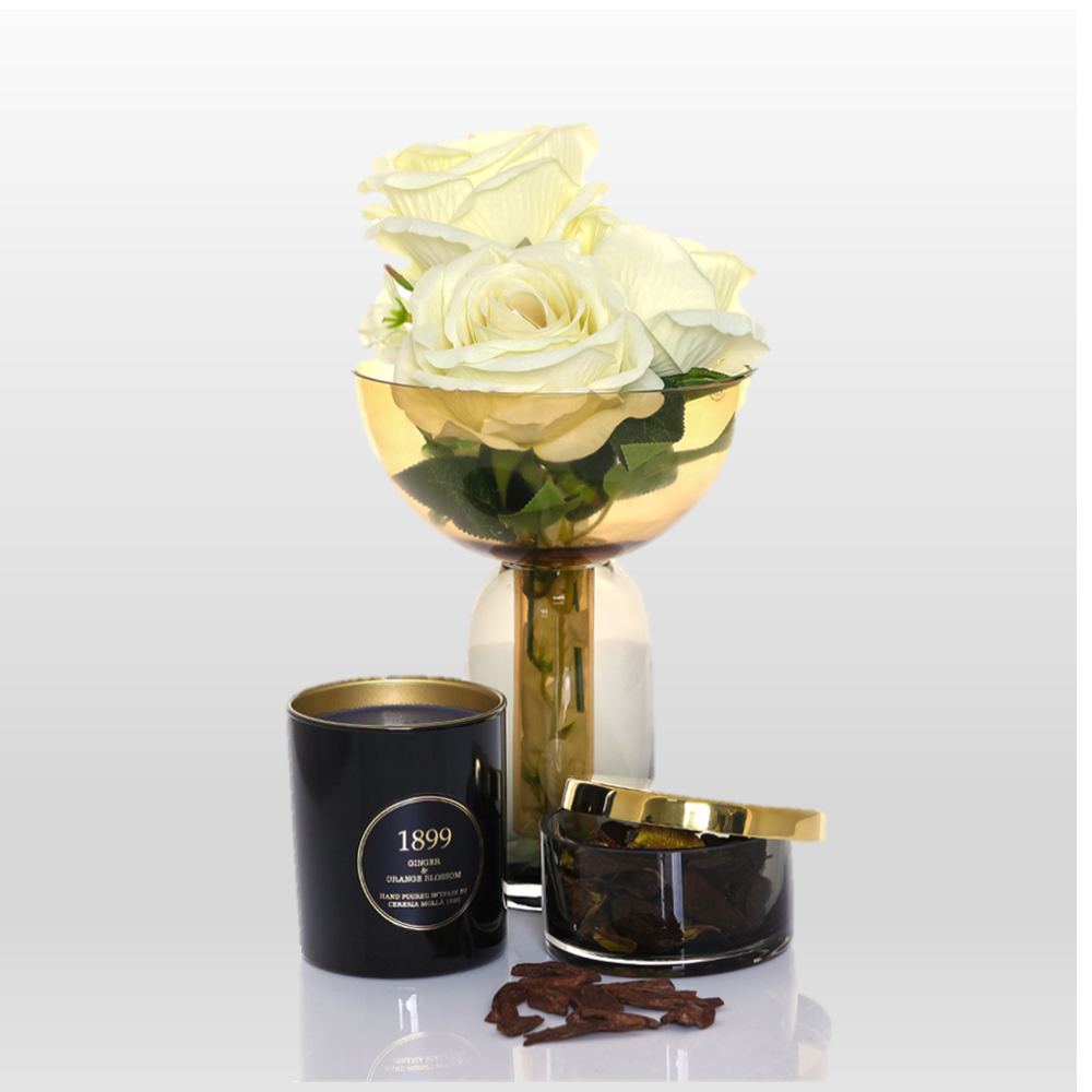 Illuminating Scents: This warming Eid Hamper includes a Cereria Molla Ginger and Orange Blossom Scented Candle, AYTM Torus Vase and AYTM Tota Jar with lid, so that you can fill your home with the most delicious smells.
