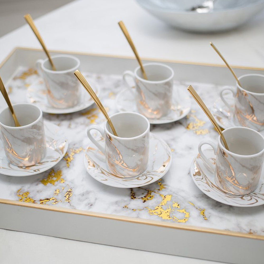 Sparkling Conversation: Comprising of the ultra-chic Aulica Coffee Cup Set and marble Tray, you can stir up the flavour and chat with the ultra-glamorous HM Istanbul gold mat Tea Spoon Set.