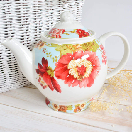 Tea pot or ceramic kettle with tropical floral print