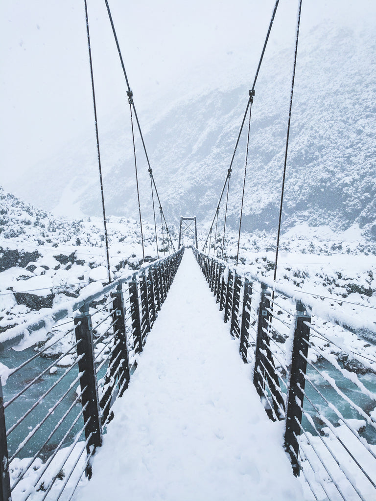 Winter hiking over a bridge