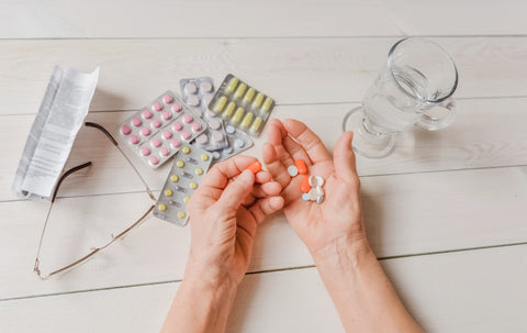 TabTime - Outstretched Hands Taking Vitamin Supplements