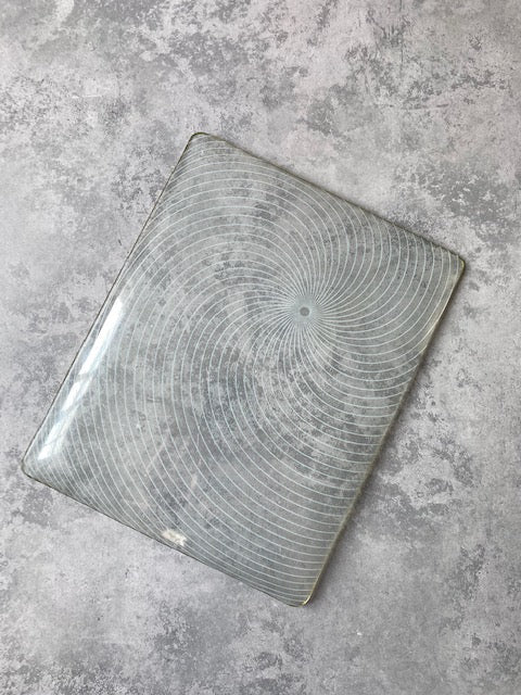 B3. Mid-century glass plate with radial swirl pattern