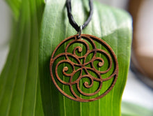 Spiral Circle Pendant in wood on leather cord