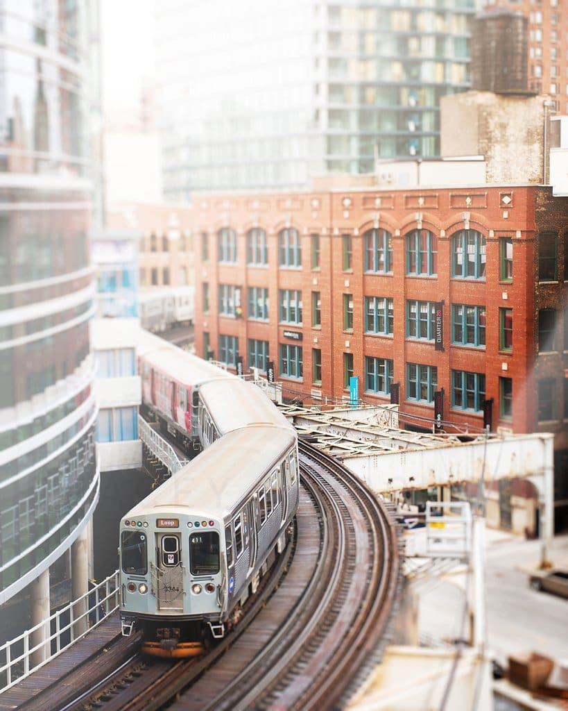 a train on the tracks in a city