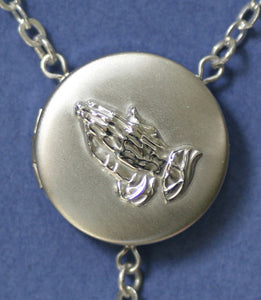 embossed praying hands locket rosary