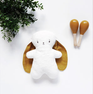 mustard baby bunny toy with baby marcacas