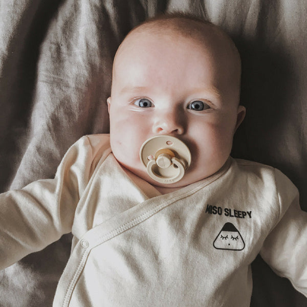 baby girl wearing miso sleepy organic baby clothes
