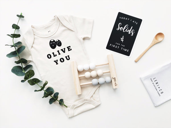 Olive you organic baby clothe with milestone card and baby abacus