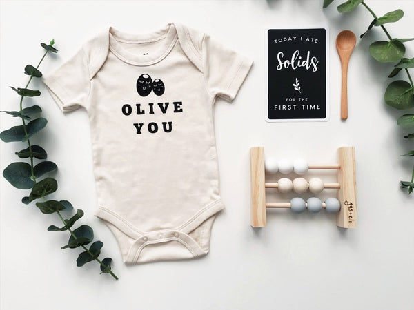 Olive you organic romper with baby abacus and baby milestone card and wooden spoon