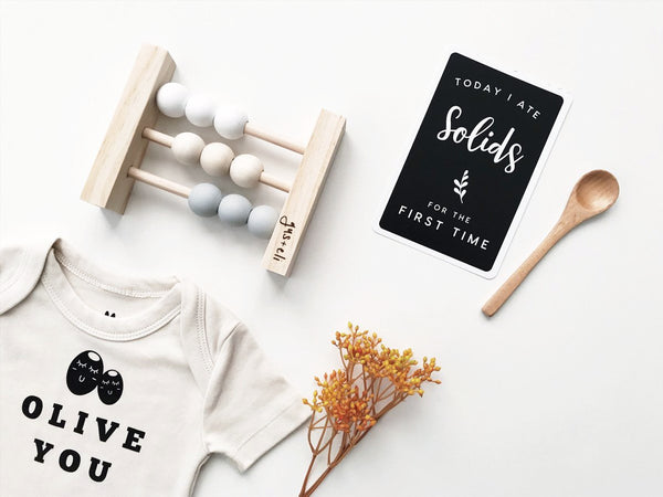 olive you abby organic romper with baby abacus and baby milestone card
