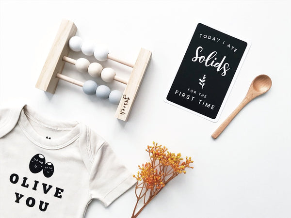 Olive you organic romper with baby abacus and baby milestone card