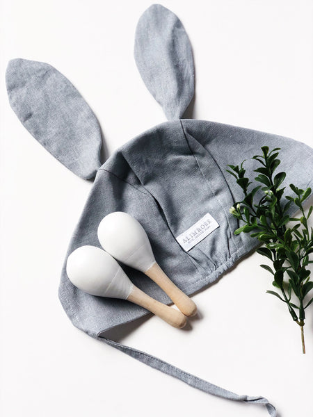grey baby bunny bonnet and baby maracas toy
