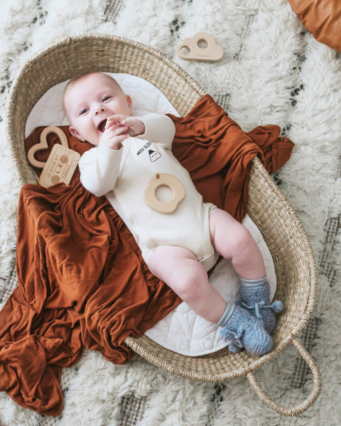 baby in bassinet wearing organic miso sleepy kimono