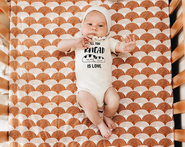 baby wearing all you knead is love organic romper
