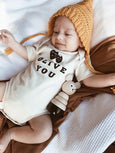 baby boy wearing olive you organic romper
