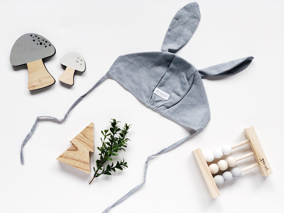 baby grey bunny bonnet with baby wooden abacus
