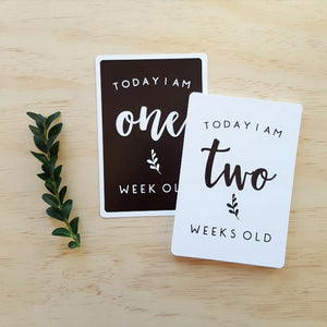 Baby milestone card in black and white design