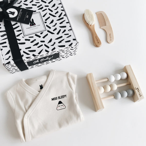 baby abacus with miso sleepy organic baby clothes and toki baby gift box