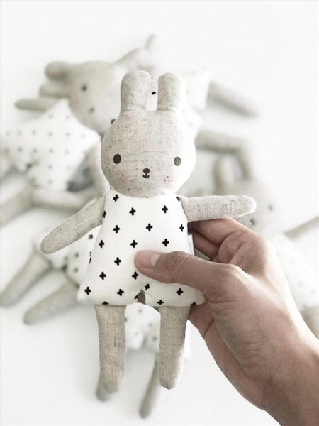 A person holding bunny rattle