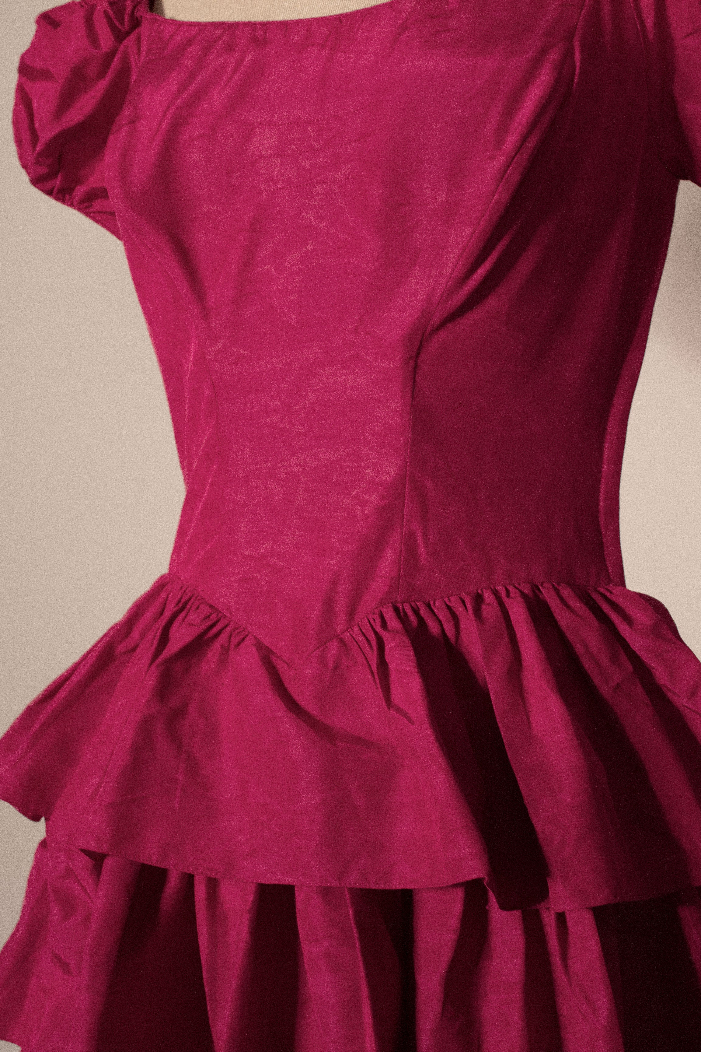 Magenta vintage puff sleeved corsetted ruffled gown