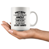 Don't mess with me I have a crazy uncle, cuss, punch in face hard black gift coffee mug