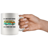 Hippie car cat on a dark desert highway cool wind in my hair white coffee mugs