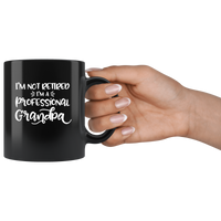 I Am Not Retired I'm A Professional Grandpa Black Coffee Mug
