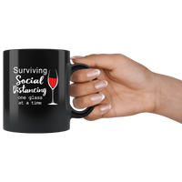 Surviving Social Distancing One Glass At A Time Quarantine Gift Black Coffee Mug