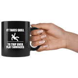 It takes skill to trip over flat surfaces black coffee mug