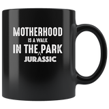 Motherhood is a walk in the jurassic park mother black coffee mug