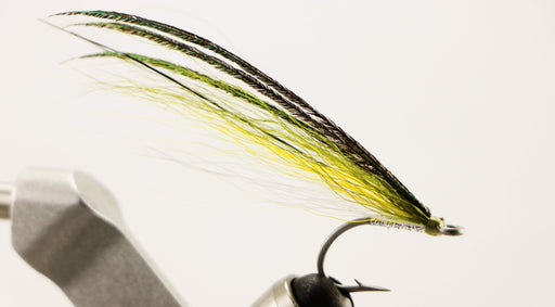 Iconic white, yellow and olive saltwater fly