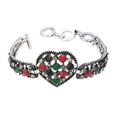 Sukkhi Heart Shaped Oxidized Silver Bracelet With Multi Colored Stones For Women