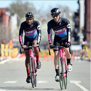 two beginner cyclist in custom champion system jerseys and bib shorts