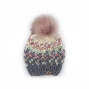 The Sunrise Beanie in Oxford Grey, Carousel and Cream with a Blossom Pom