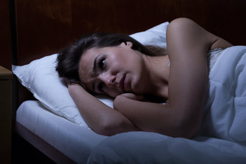 Woman can't sleep because of Poor Sleep Patterns