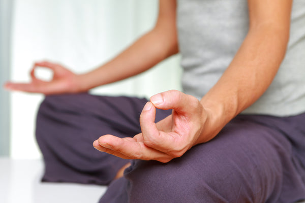 Woman mediating to help with Chakra flow