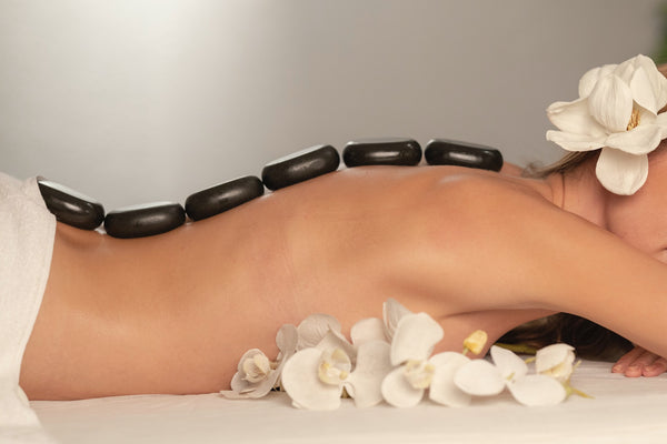 woman getting a massage with essential oils to relieve back pain