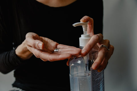 hand sanitzer being applied to woman's hand