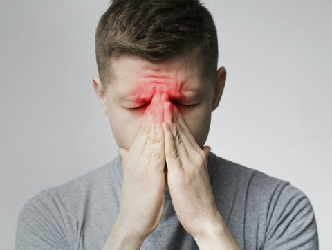 man using essential oils for Sinus infection