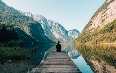 woman meditating for mental clarity using aromatherapy essential oils